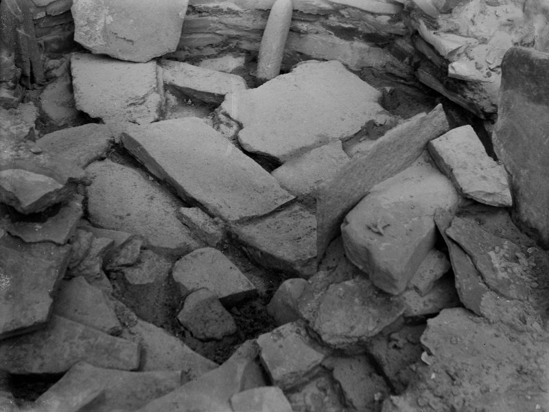 Excavation photograph: House 2, detail of tumbled stones filling N. W. corner of house, door jamb visible top left. Copy negative 1995. Original print in Print Room.
