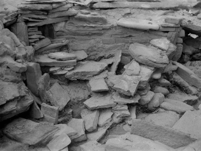 Excavation photograph: House 2, Tumbled stones filling S. W. corner of house, between passage entrance ( top left ) and main entrance ( top right ).