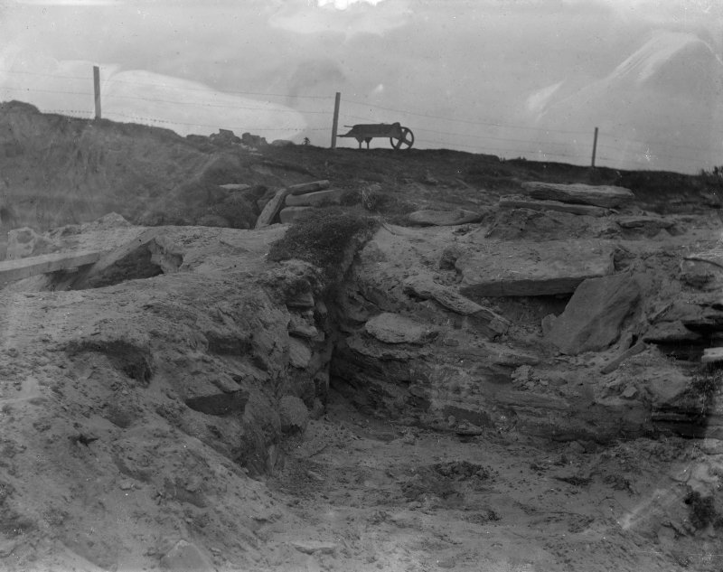Excavation photograph: Junction between house 2 ( left ) and house 1 ( right ) from W. Copy negative 1995. Original print in Print Room.