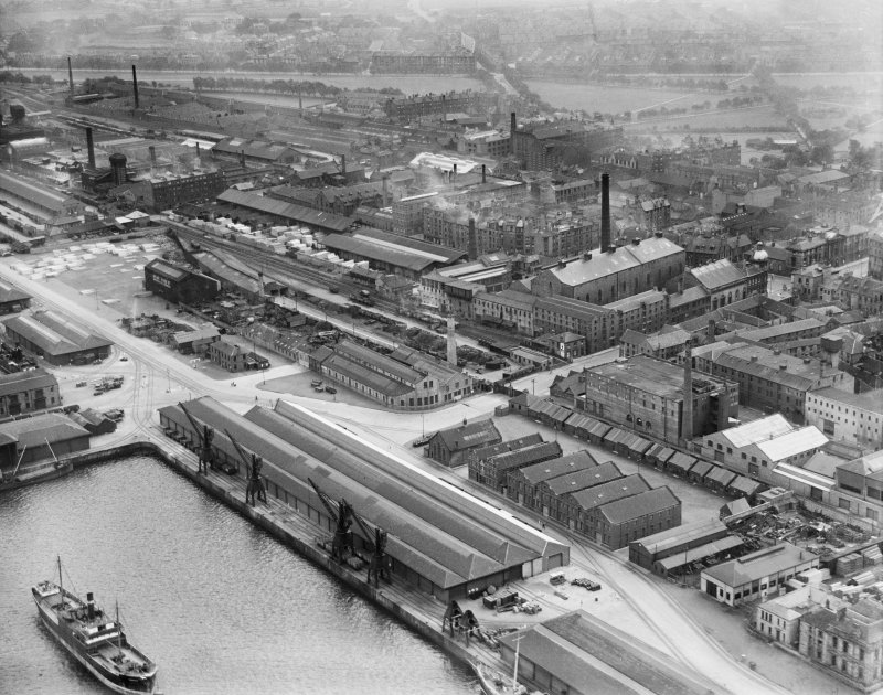 Edinburgh, general view, showing Garland and Roger Ltd. Timber Yard, Baltic Street and Leith Links.  Oblique aerial photograph taken facing south.
