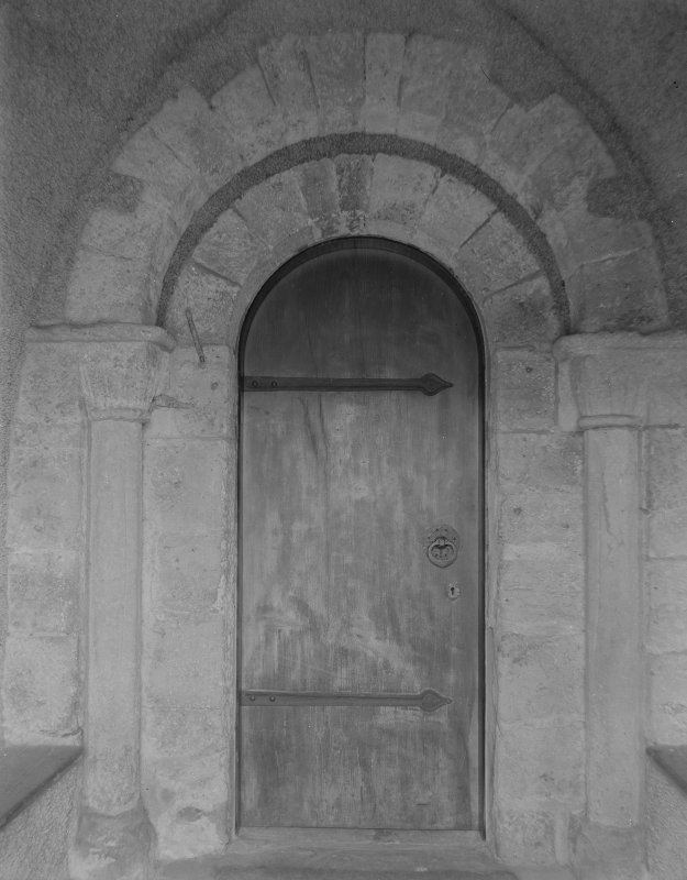 S porch, inner end, detail of Romanesque doorway with nookshafts and cushion capitals.