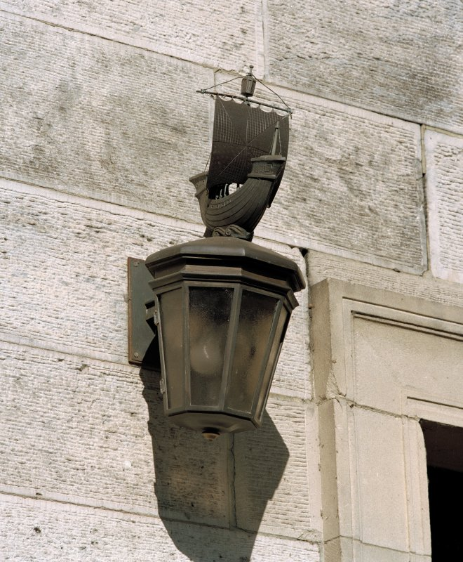 Detail of lantern with ship ornament.
