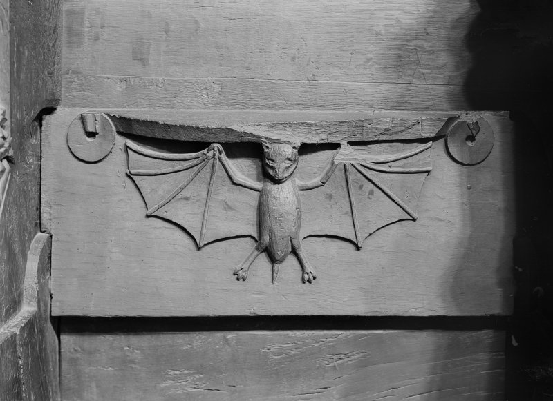 Interior. Choir, detail of misericord showing a bat.