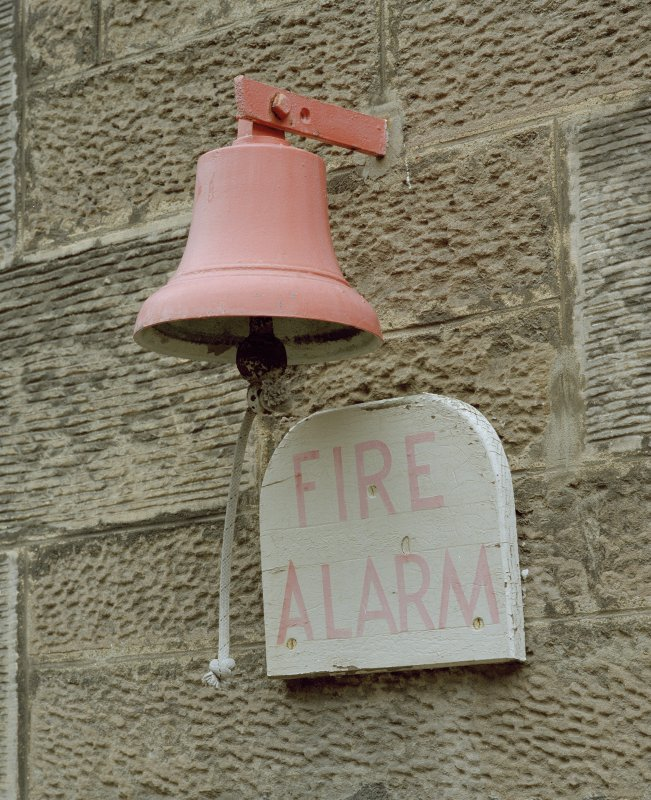 Courtyard to rear, detail of fire alarm bell