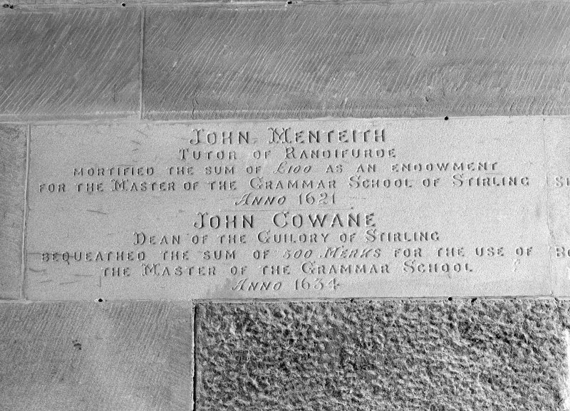 "Detail of commemorative plaque with inscription ""John Menteith. Tutor of Randifurde. Mortified the Sum of £100 as an Endowment For the Master of the Grammar School of Stirling. Anno 1621. John Cowane. Dean of the Guildry of Stirling. Bequeathed the SUm of 500 Merks for the Use of the Master of the Grammar School. Anno 1634"""