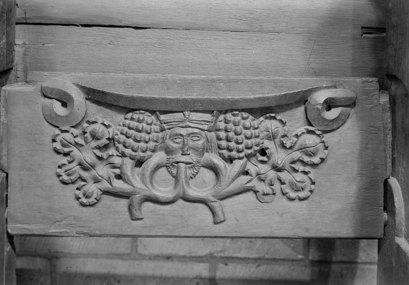 Choir, detail of misericord - vine and mask.