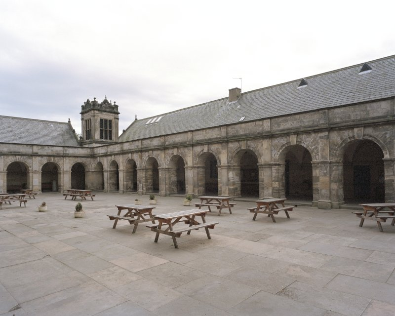 General view of South block, courtyard and cloisters from North East