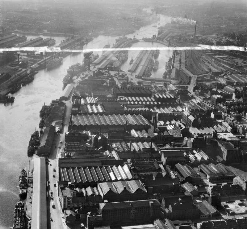 Glasgow, general view, showing Harland and Wolff Diesel Engine Works, 181 Lancefield Street and Queen's Dock.  Oblique aerial photograph taken facing west.  This image has been produced from a crop marked negative.