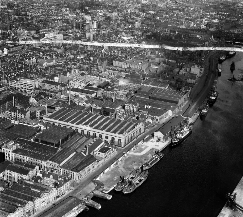 Glasgow, general view, showing Harland and Wolff Diesel Engine Works, 181 Lancefield Street and Anderston Quay.  Oblique aerial photograph taken facing east.  This image has been produced from a crop  ...