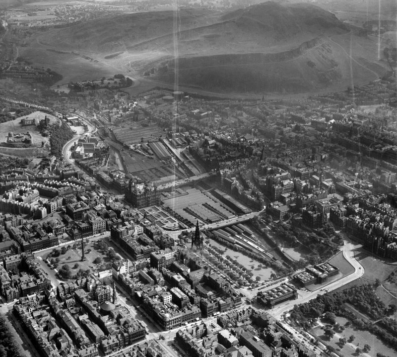 Edinburgh, general view, showing Waverley Station and Holyrood Park.  Oblique aerial photograph taken facing east.