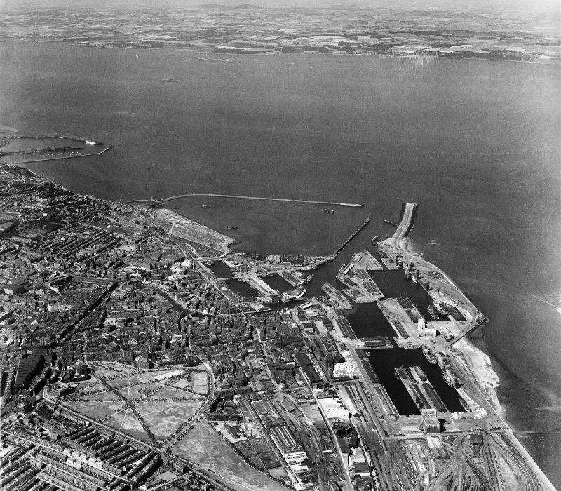 Edinburgh, general view, showing Leith Docks and Leith Links.  Oblique aerial photograph taken facing north.