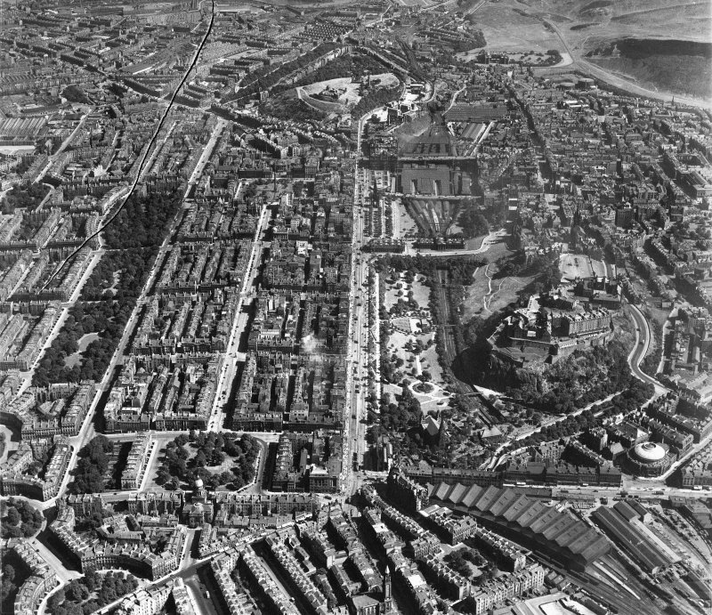 Edinburgh, general view, showing Princes Street and Edinburgh Castle.  Oblique aerial photograph taken facing east.