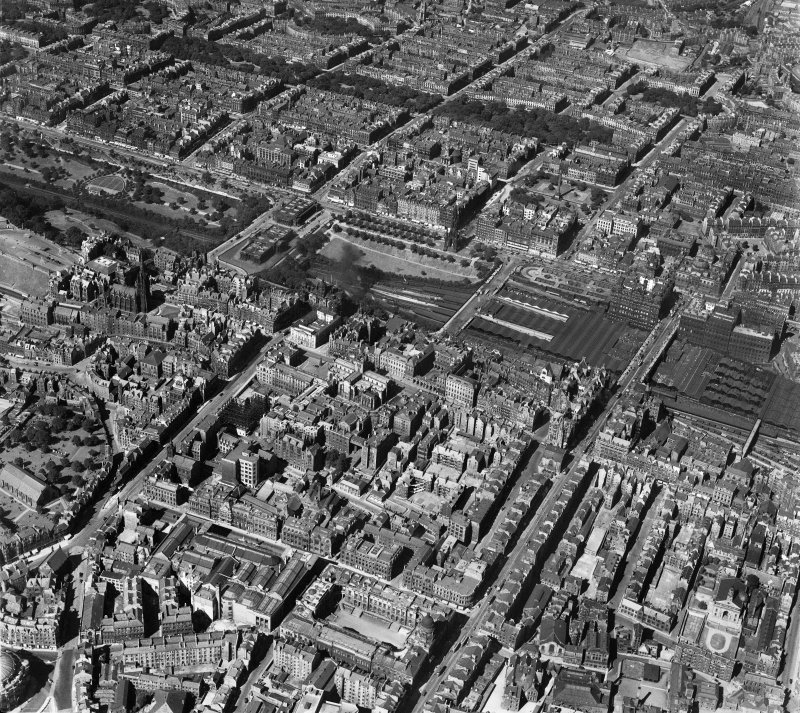 Edinburgh, general view, showing Waverley Station and Chambers Street.  Oblique aerial photograph taken facing north-west.