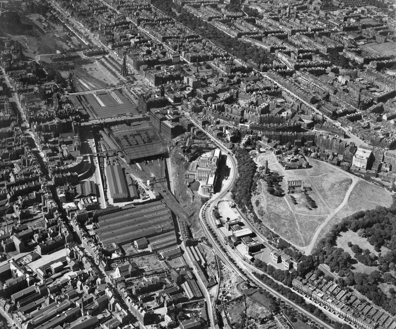 Edinburgh, general view, showing Waverley Station and Calton Hill.  Oblique aerial photograph taken facing west.