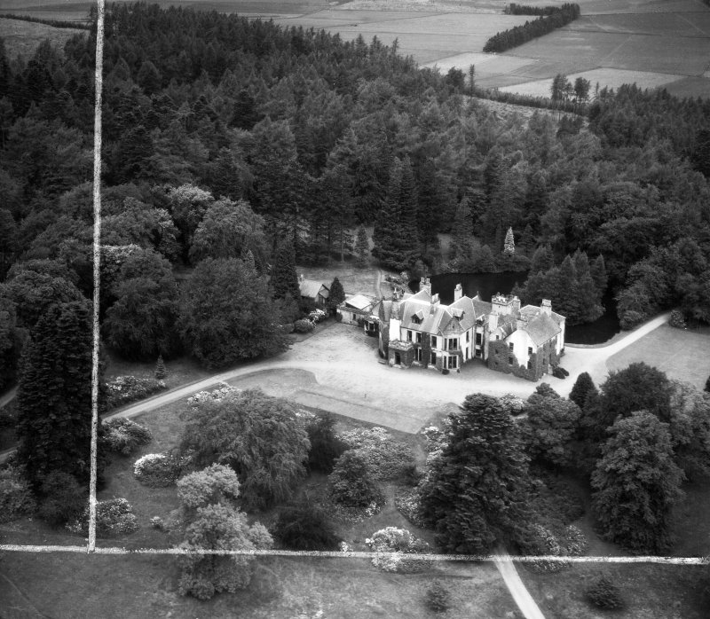 Knockespock House, Clatt.  Oblique aerial photograph taken facing north.  This image has been produced from a crop marked negative.