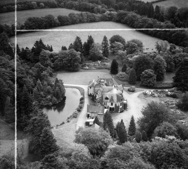 Knockespock House, Clatt.  Oblique aerial photograph taken facing east.  This image has been produced from a crop marked negative.