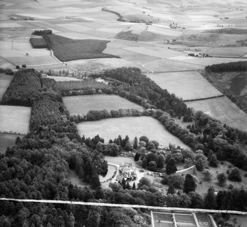 Knockespock House and Estate, Clatt.  Oblique aerial photograph taken facing east.  This image has been produced from a crop marked negative.