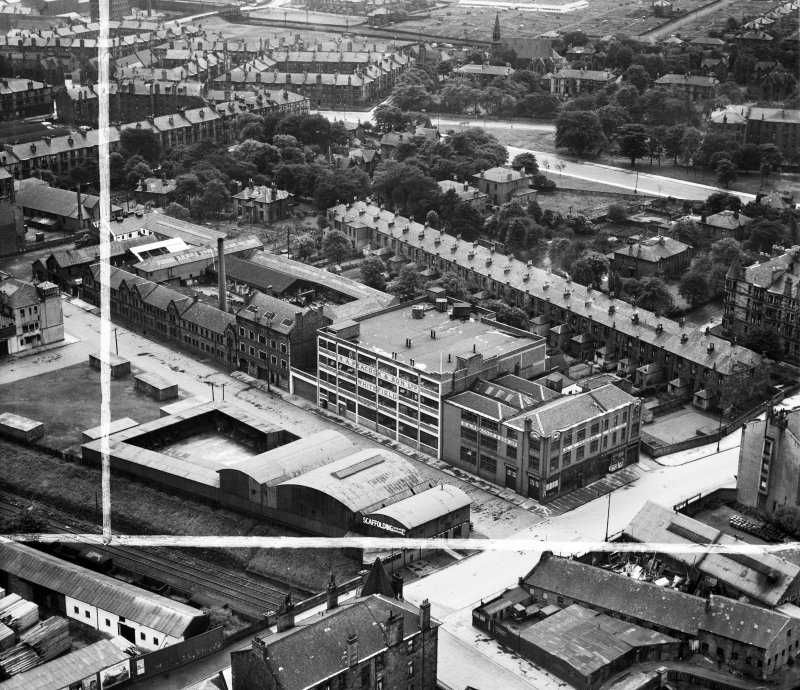 Glasgow, general view, showing R A Peacock and Son Ltd. Whitefield Bakery, Fairley Street and Ibrox Terrace.  Oblique aerial photograph taken facing south.  This image has been produced from a crop ma ...