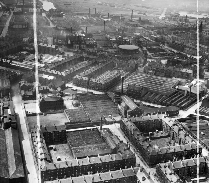 Glasgow, general view, showing David and John Anderson Ltd. Atlantic Mills, Walkinshaw Street and Baltic Street.  Oblique aerial photograph taken facing south.  This image has been produced from a crop marked negative.