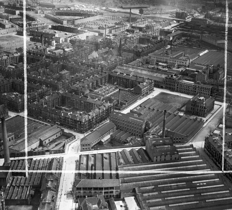 Glasgow, general view, showing David and John Anderson Ltd. Atlantic Mills, Walkinshaw Street and Dunn Street.  Oblique aerial photograph taken facing north-east.  This image has been produced from a crop marked negative.