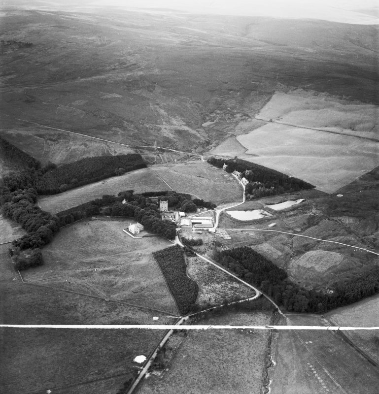 Cranshaws Castle and grounds.  Oblique aerial photograph taken facing west.  This image has been produced from a crop marked negative.