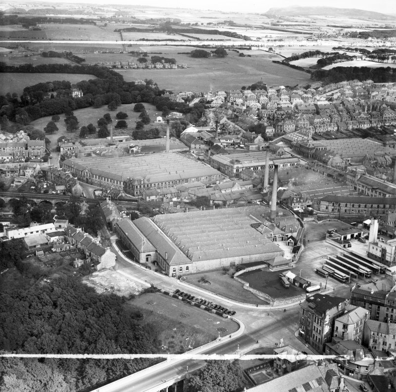 Dunfermline, general view, showing Winterthur Silks Ltd. Canmore Works, Bruce Street and Glen Bridge.  Oblique aerial photograph taken facing north.  This image has been produced from a crop marked negative.