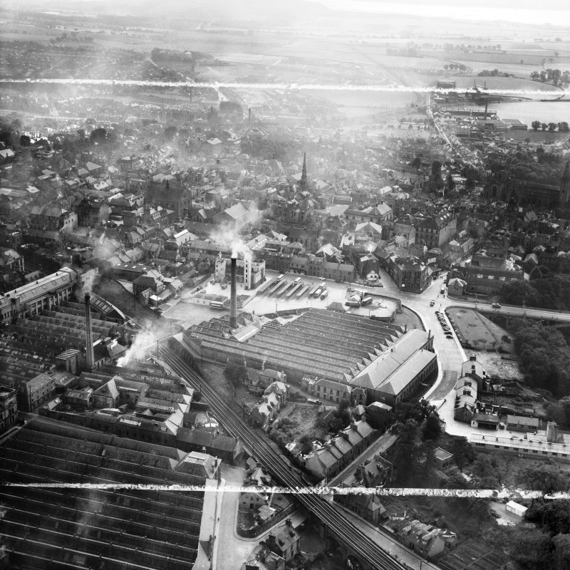 Dunfermline, general view, showing Winterthur Silks Ltd. Canmore Works, Bruce Street and Carnegie Drive.  Oblique aerial photograph taken facing south.  This image has been produced from a crop marked negative.