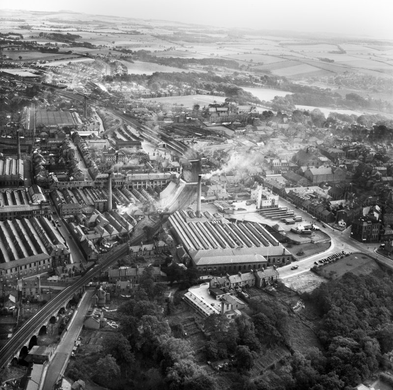 Dunfermline, general view, showing Winterthur Silks Ltd. Canmore Works, Bruce Street and Carnegie Drive.  Oblique aerial photograph taken facing east.