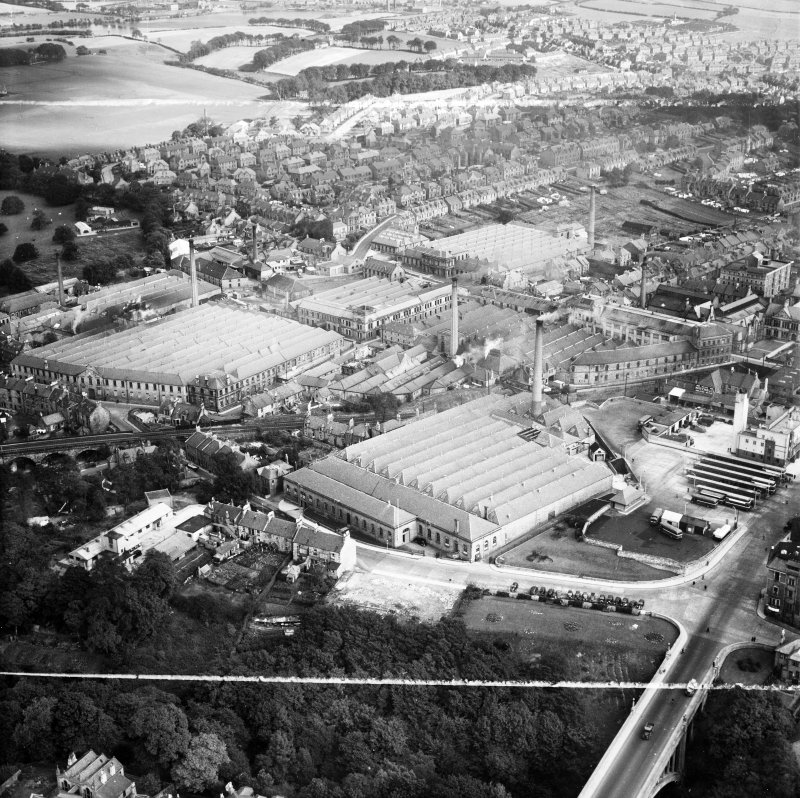 Dunfermline, general view, showing Winterthur Silks Ltd. Canmore Works, Bruce Street and Pilmuir Works, Pilmuir Street.  Oblique aerial photograph taken facing north-east.  This image has been produced from a crop marked negative.
