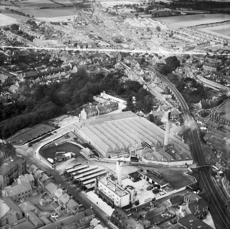 Dunfermline, general view, showing Winterthur Silks Ltd. Canmore Works, Bruce Street and Buffies Brae.  Oblique aerial photograph taken facing north-west.  This image has been produced from a crop marked negative.