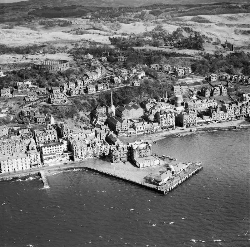 Oban, general view, showing North Pier and McCaig's Tower.  Oblique aerial photograph taken facing east.