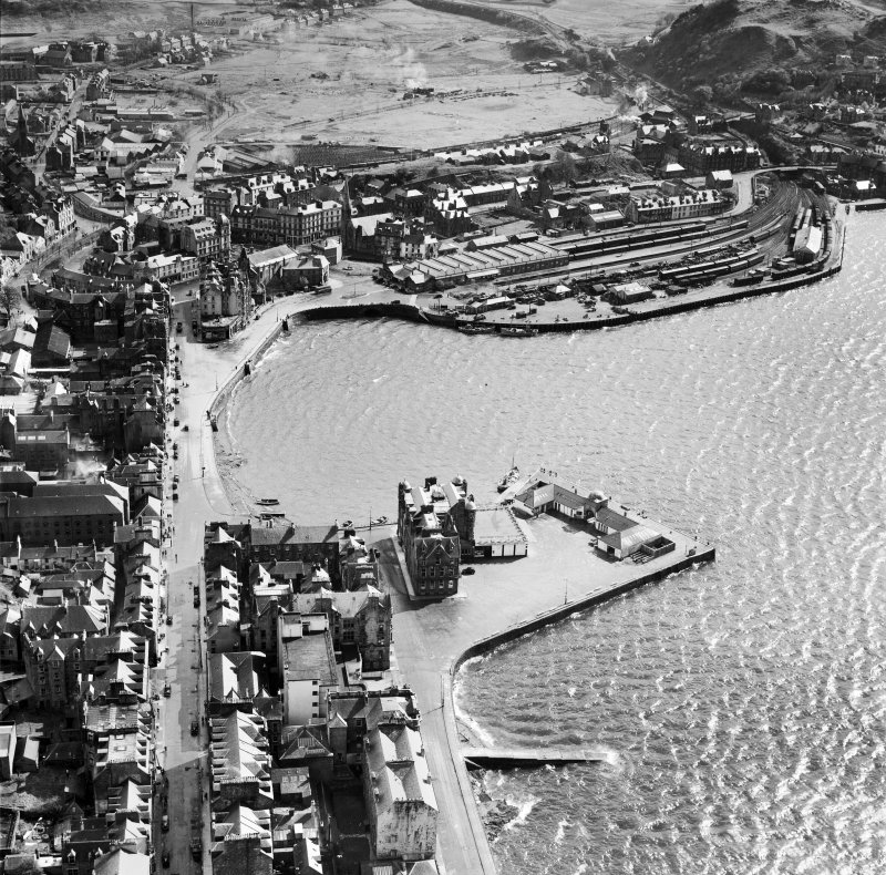 Oban, general view, showing North Pier and Railway Quay.  Oblique aerial photograph taken facing south.