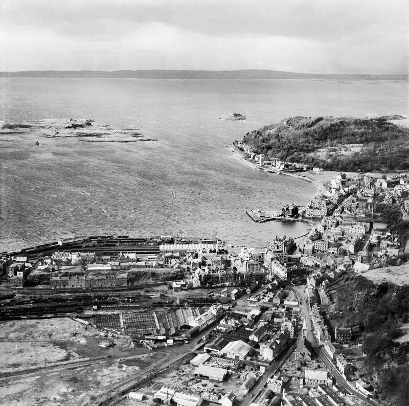 Oban, general view, showing North Pier and Barra Mor.  Oblique aerial photograph taken facing north.