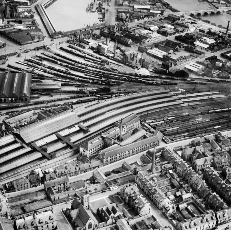 Aberdeen, general view, showing Wiggins Teape Ltd. Pirie Appleton and Co. Paper Mills, College Street and Aberdeen Joint Railway Station.  Oblique aerial photograph taken facing east.