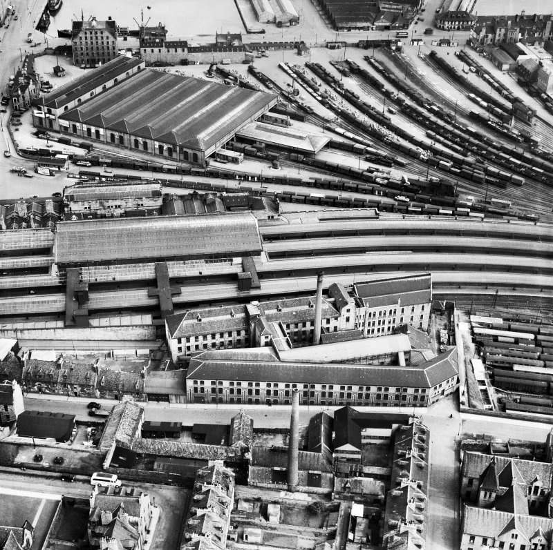 Wiggins Teape Ltd. Pirie Appleton and Co. Paper Mills, College Street and Aberdeen Joint Railway Station, Aberdeen.  Oblique aerial photograph taken facing east.