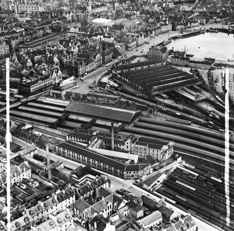 Aberdeen, general view, showing Wiggins Teape Ltd. Pirie Appleton and Co. Paper Mills, College Street and Aberdeen Joint Railway Station.  Oblique aerial photograph taken facing north-east.  This image has been produced from a crop marked negative.