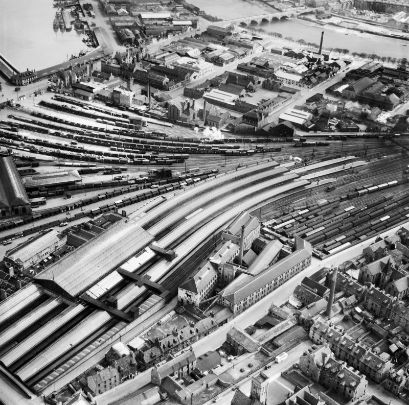 Wiggins Teape Ltd. Pirie Appleton and Co. Paper Mills, College Street and Aberdeen Joint Railway Station, Aberdeen.  Oblique aerial photograph taken facing south-east.