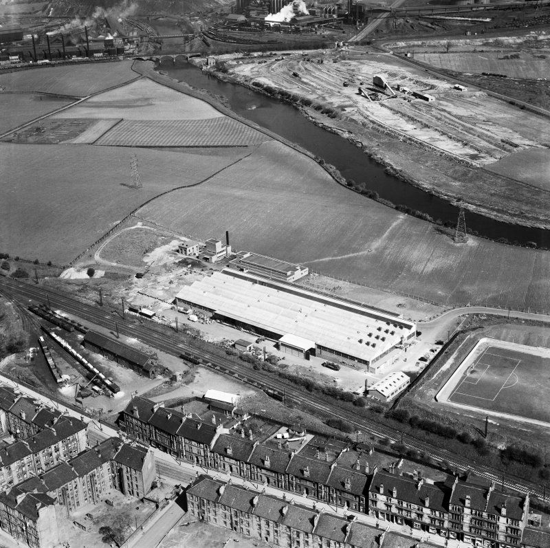 Glasgow, general view, showing Hoover (Electric Motors) Ltd. Cambuslang Works, Somervell Street and Bogeshole Road Bridge.  Oblique aerial photograph taken facing north.