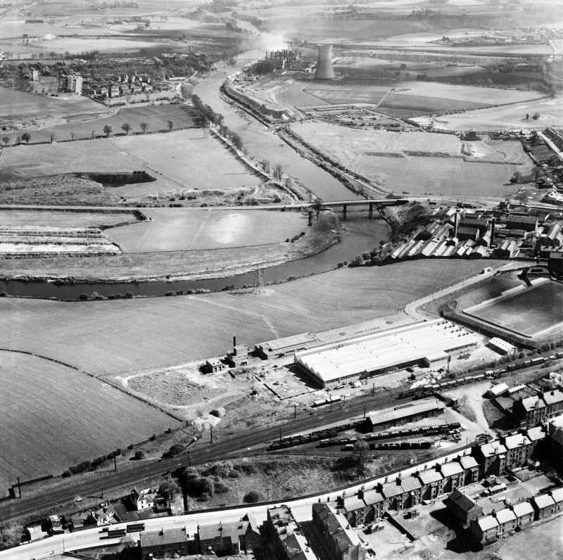 Glasgow, general view, showing Hoover (Electric Motors) Ltd. Cambuslang Works, Somervell Street and Cambuslang Bridge.  Oblique aerial photograph taken facing east.