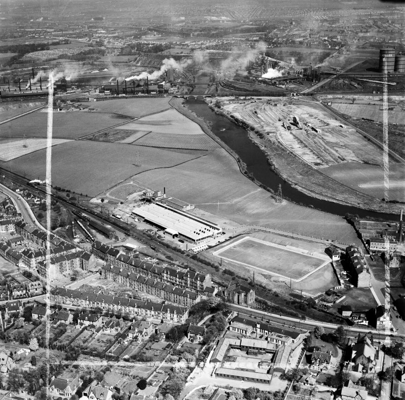 Glasgow, general view, showing Hoover (Electric Motors) Ltd. Cambuslang Works, Somervell Street and Bogeshole Road Bridge.  Oblique aerial photograph taken facing north.  This image has been produced from a crop marked negative.