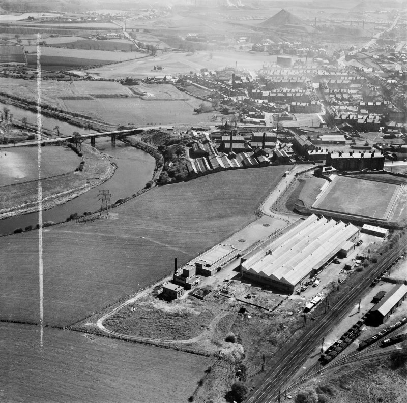 Glasgow, general view, showing Hoover (Electric Motors) Ltd. Cambuslang Works, Somervell Street and Cambuslang Bridge.  Oblique aerial photograph taken facing east.  This image has been produced from a crop marked negative.