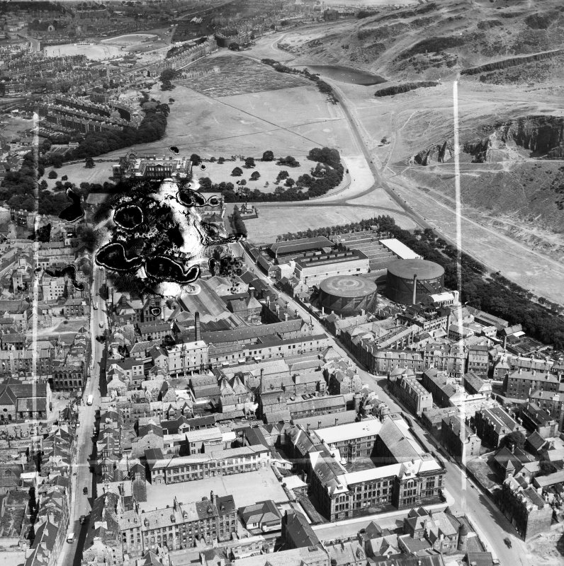 Edinburgh, general view, showing William Younger and Co. Ltd. Holyrood Brewery and Holyrood Park.  Oblique aerial photograph taken facing east.  This image has been produced from a damaged and crop marked negative.