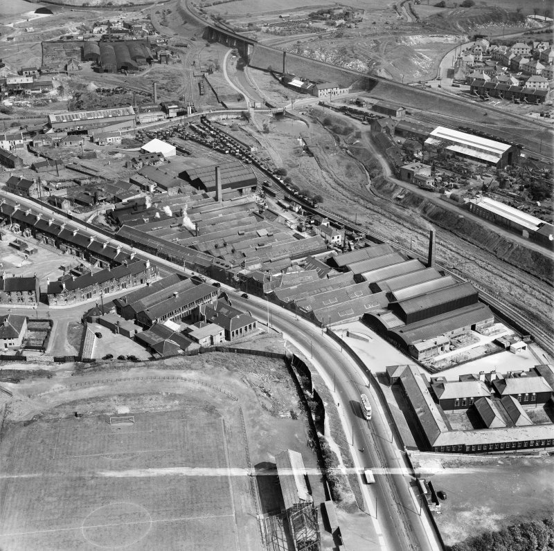 Stewarts and Lloyds Ltd. Works, Main Street, Coatbridge.  Oblique aerial photograph taken facing south-east.  This image has been produced from a crop marked negative.