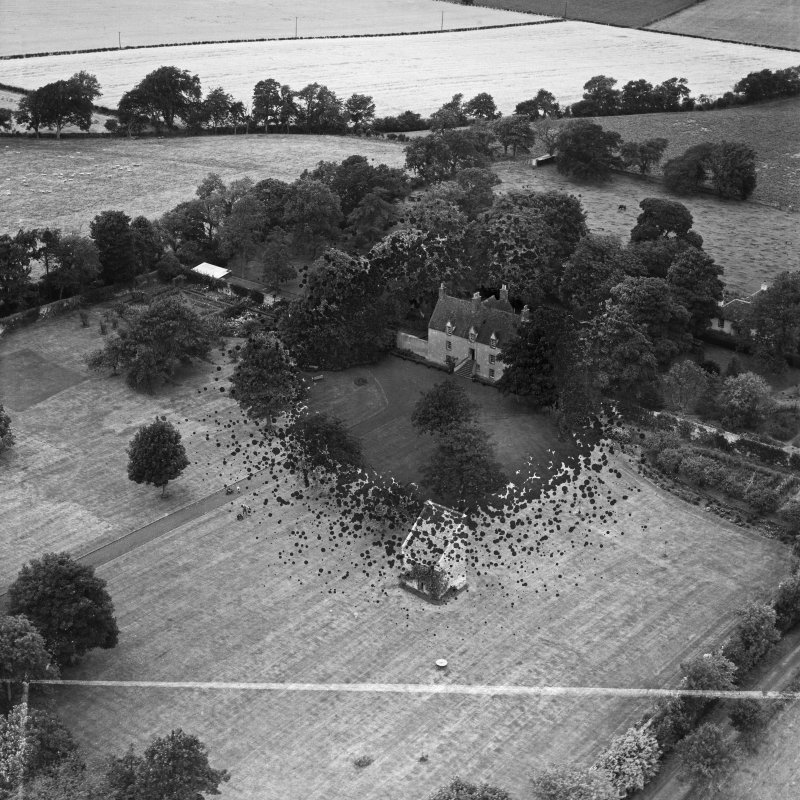 Pilmuir House and Dovecot, Haddington.  Oblique aerial photograph taken facing north-west.  This image has been produced from a damaged and crop marked negative.