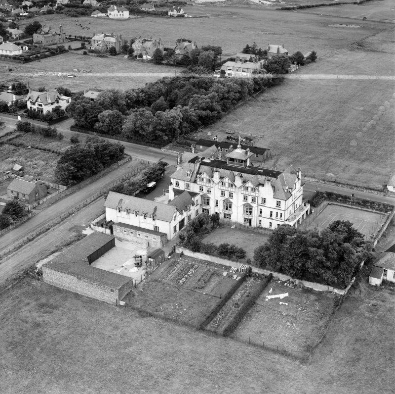 Marine Hotel, Main Street, Gullane.  Oblique aerial photograph taken facing north-west.  This image has been produced from a crop marked negative.
