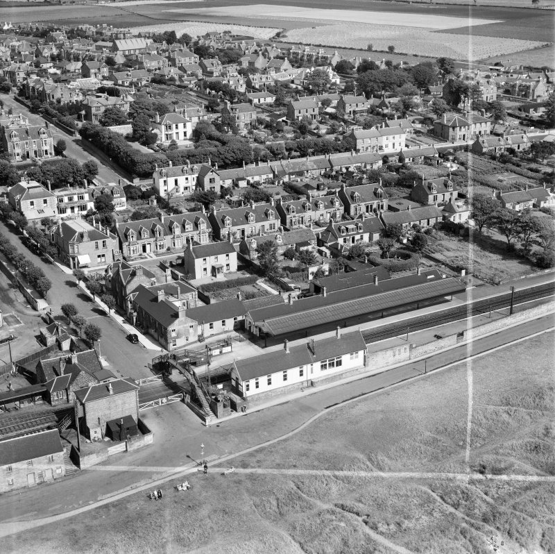 Carnoustie, general view, showing Station Hotel, Station Road and Church Street.  Oblique aerial photograph taken facing north.  This image has been produced from a crop marked negative.