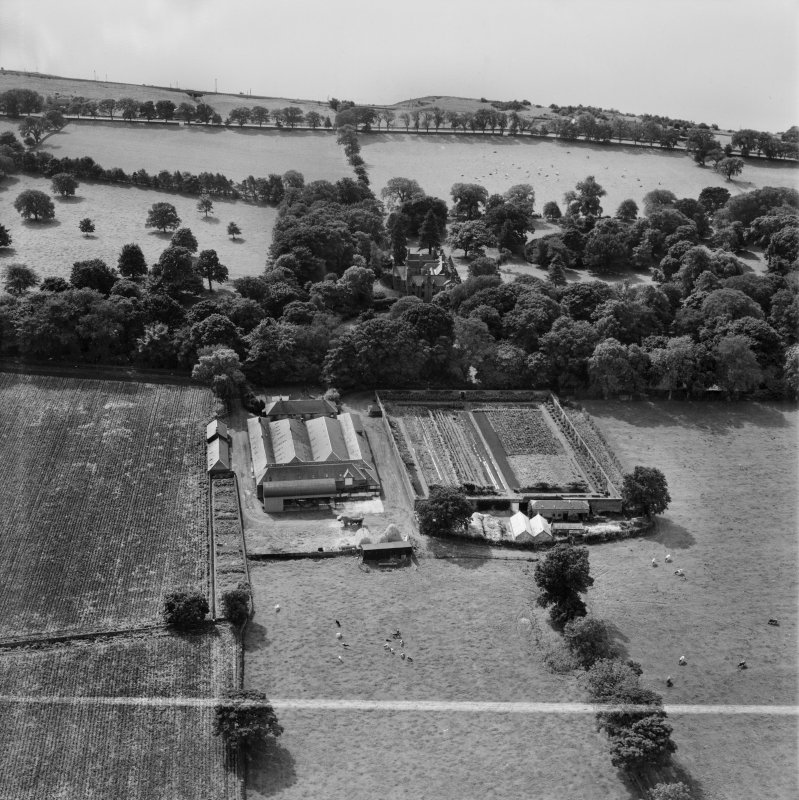 Invergowrie House and Farmstead, Ninewells, Dundee.  Oblique aerial photograph taken facing south.  This image has been produced from a crop marked negative.