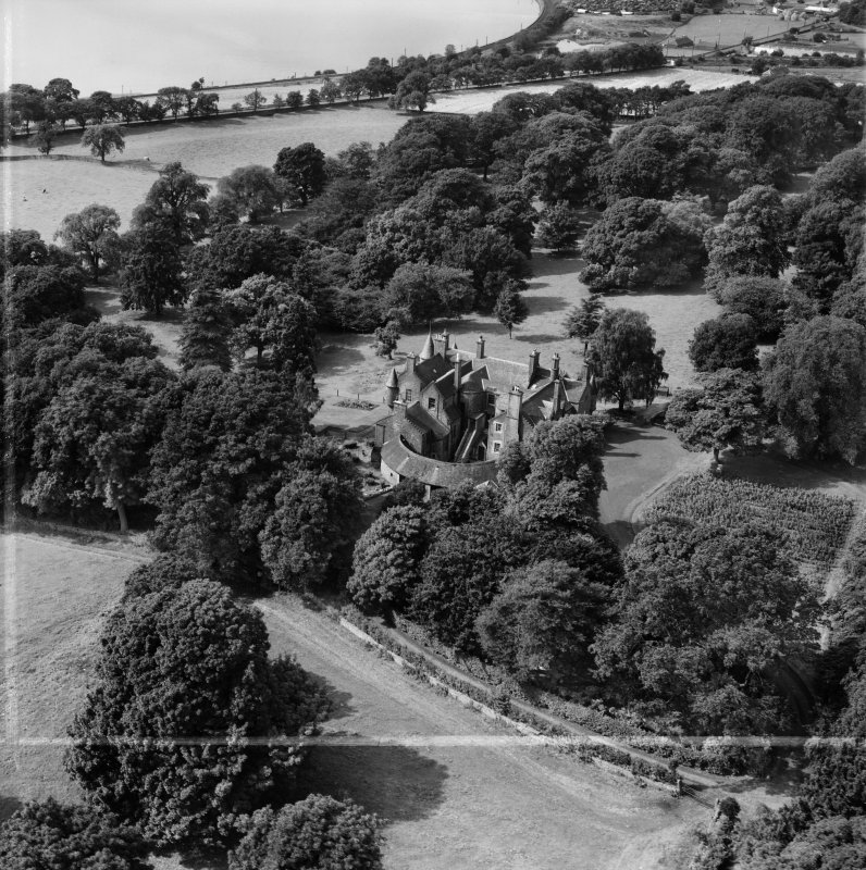 Invergowrie House, Ninewells, Dundee.  Oblique aerial photograph taken facing west.  This image has been produced from a crop marked negative.