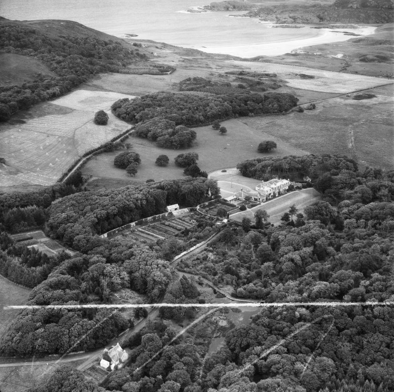 Colonsay House and Gardens, Kiloran and Kiloran Bay, Colonsay.  Oblique aerial photograph taken facing north.  This image has been produced from a crop marked negative.