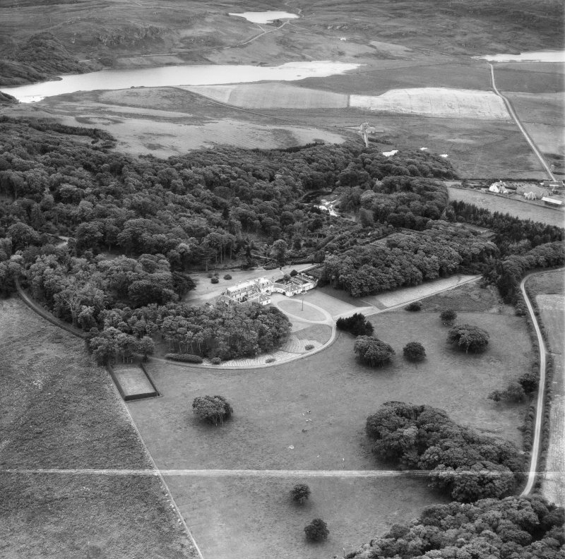 Kiloran, general view, showing Colonsay House and Loch Fada.  Oblique aerial photograph taken facing south.  This image has been produced from a crop marked negative.